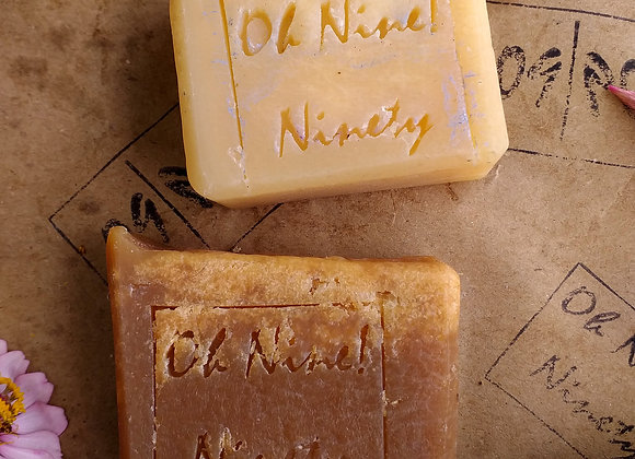 Closeup of Oh Nine! Ninety 09! Legend-Star beer soap bars on brown logo-stamped paper.