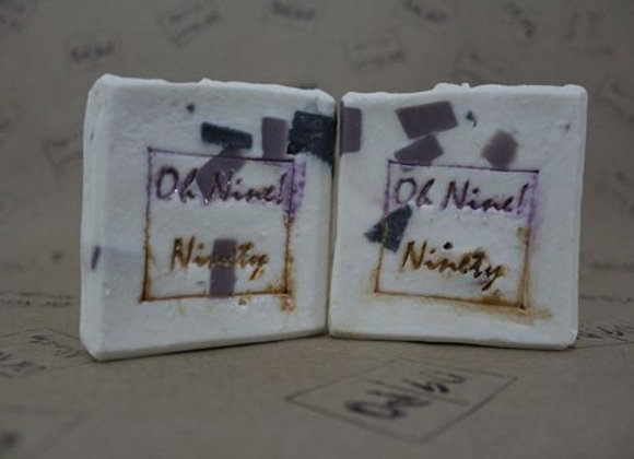Oh Nine! Ninety Block in Ice handmade natural soap on brown logo-stamped paper.