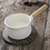Thumbnail: Enamel Milk Pan in White with Wooden Handle