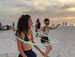 women-friends-hula-hooping.jpg