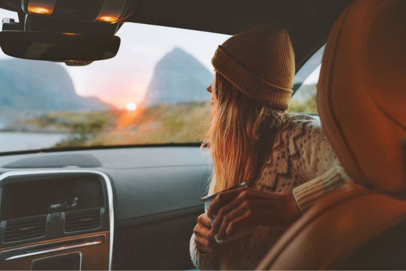 Tourists driving in Norway during sunset