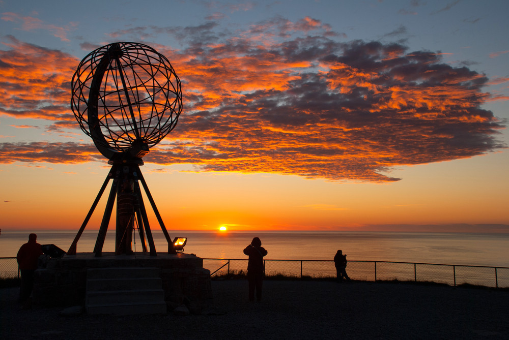 Globe monument and midnight sun in Nordkapp, Norway - Midnight sun in Norway