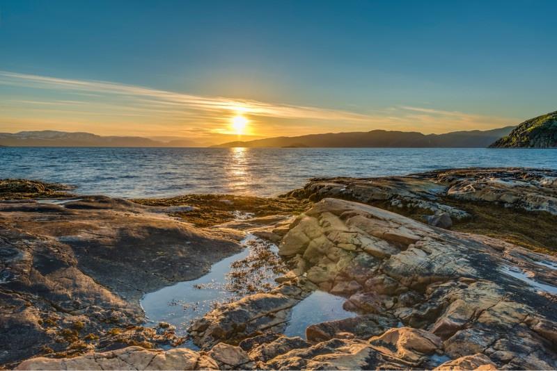 Midnight sun laying in the sea - Midnight sun in Norway