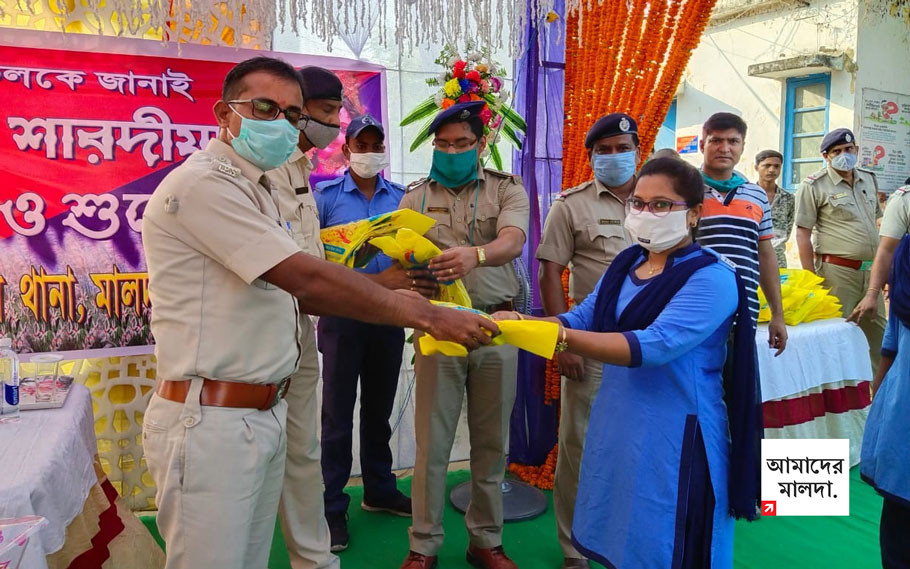 The gift of new puja clothes to the civic police