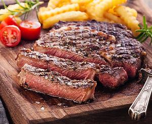 grilled-rib-eye-steaks-617b7f_edited.jpg