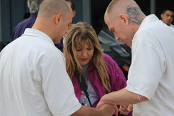 Cindy prays with men at Hutchins
