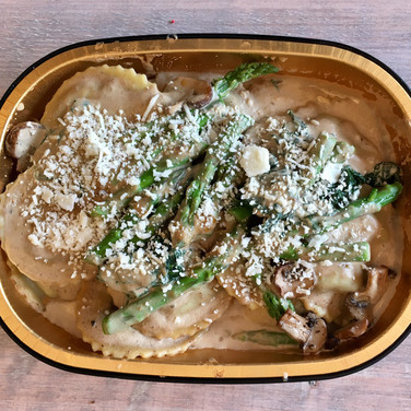 Porcini Mushroom Ravioli w/ Asparagus, Spinach, Portobello Mushrooms, Porcini Cream Sauce & Parmesan Cheese