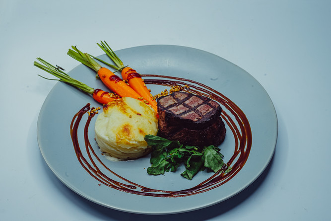 Beef Tenderloin with Balsamic Demi Glace with Chipolini Onions, Asparagus & Scalloped Potato Galette