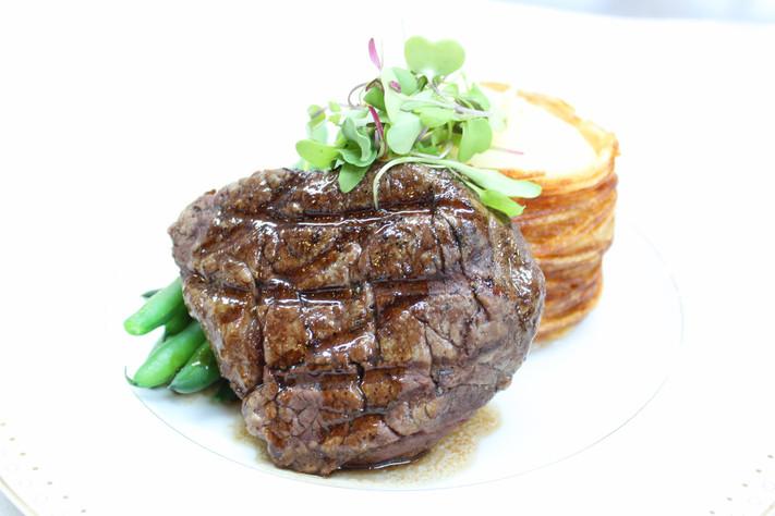 Filet Mignon of Beef w/ Mashed Yukon Potatoes in a Crispy Potato Basket