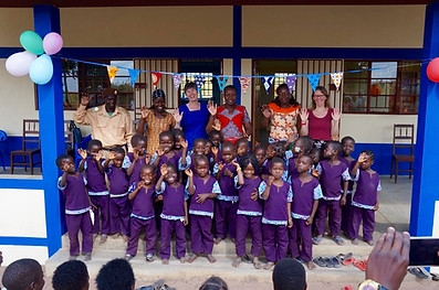 Tracy and some of our teachers and students at our new schools opening.