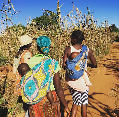 Mariah with some frinds on their way to pray for one of their Grandmothers in the village.