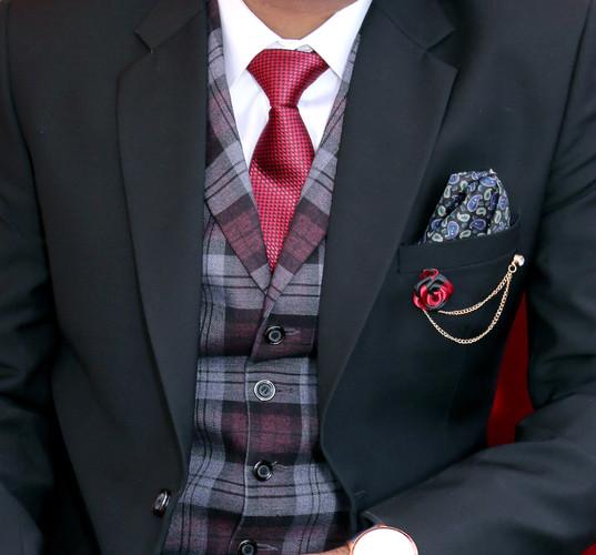 man-wearing-black-notched-lapel-suit-jac