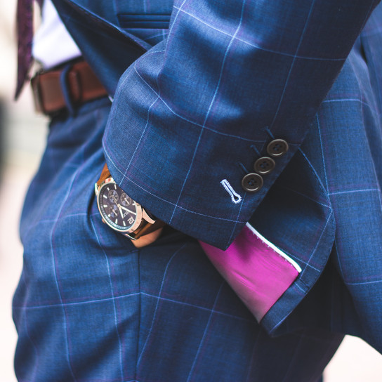 person-wearing-blue-plaid-suit-jacket-an