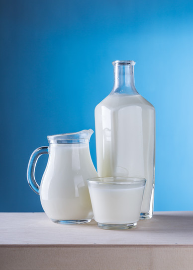 close-up-of-milk-against-blue-background