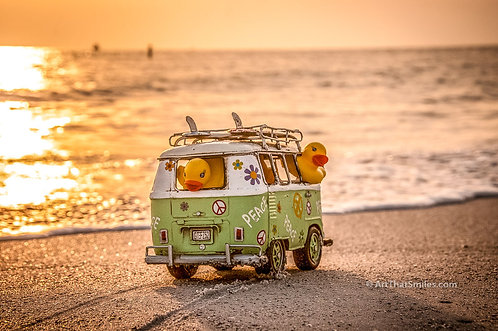 SURF'S UP - Cute and funny photograph of surfer rubber duckies in hippie van at the beach.