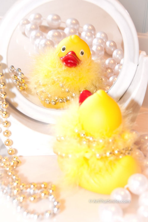 Looking Ducky - A funny photograph of rubber ducky looking all dressed up at bathroom mirror.