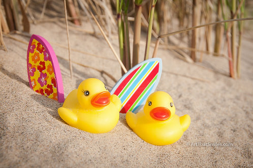 """Beachin' It"" - Photograph of surfer rubber duckies on beach with surfboards"