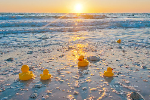 """Photograph of rubber ducky family playing on the beach shore.  Fun artfrom the """"Rubber Ducky"""" photo collection."""