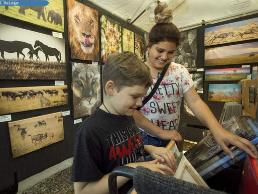 Kids enjoying my photos this past weekend at the Lake Wales Art Festival.