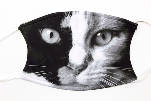 Black and white photo of a calico cat face printed on a quality fabric mask. Be feline cool.