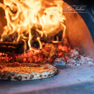 Flax Studios - Pizzas in oven