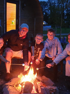 Toasting Marshmallows by Pod fire