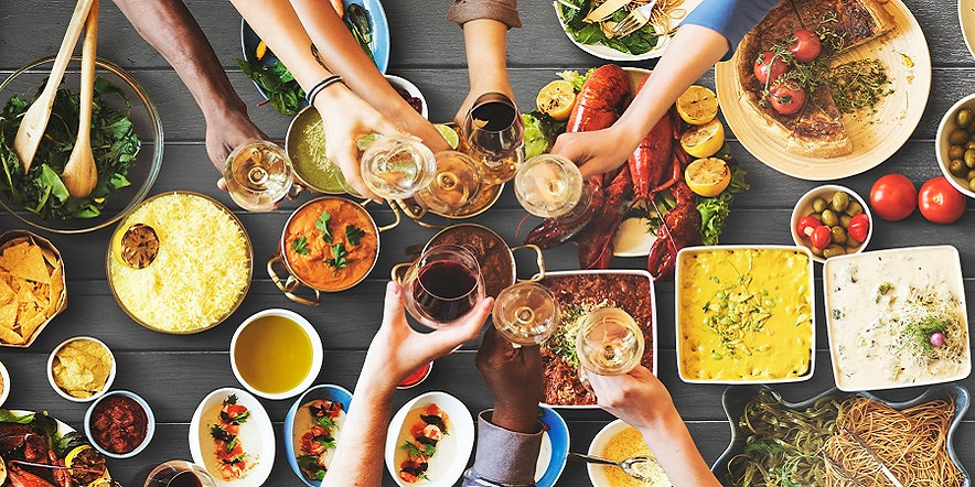 iStock-friends-and-family-enjoying-dinne