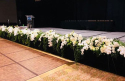white stage flowers