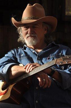 W.C. Jameson holding guitar.