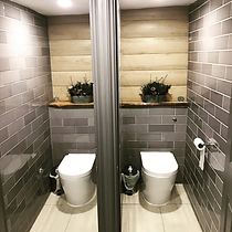 TPM Property Services - We transformed this area in a Milton Keynes restaurant into some stylish public toilets.  Fully designed, supplied and fitted by us