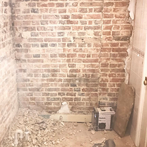 TPM Property Services - brickwall feature wall industrial preparation for a bathroom refit in a commercial property