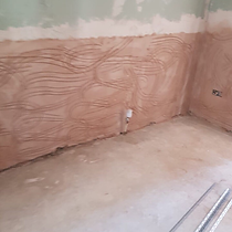 TPM Property Services - Replastered wall after water leak damage