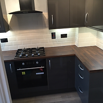 TPM Property Services - rental property budget basic dark grey kitchen with wood effect laminate worktop