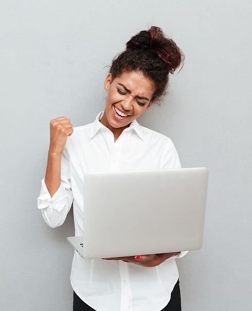 cheerful-business-woman-make-winner-gest