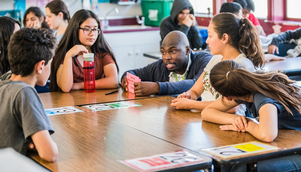 Health Educator, Nickolas Sumpter, talks with students about what makes a healthy relationship.