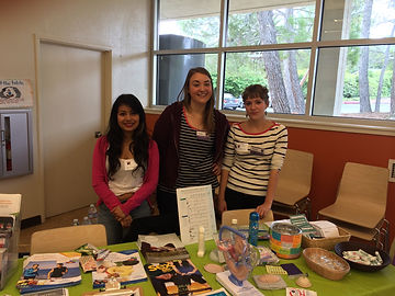 Health educators and Youth Advisory Board members at a health fair outreach event.