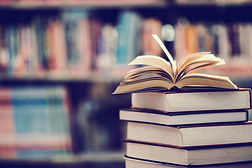 Book in library with open textbook,education learning concept.jpg