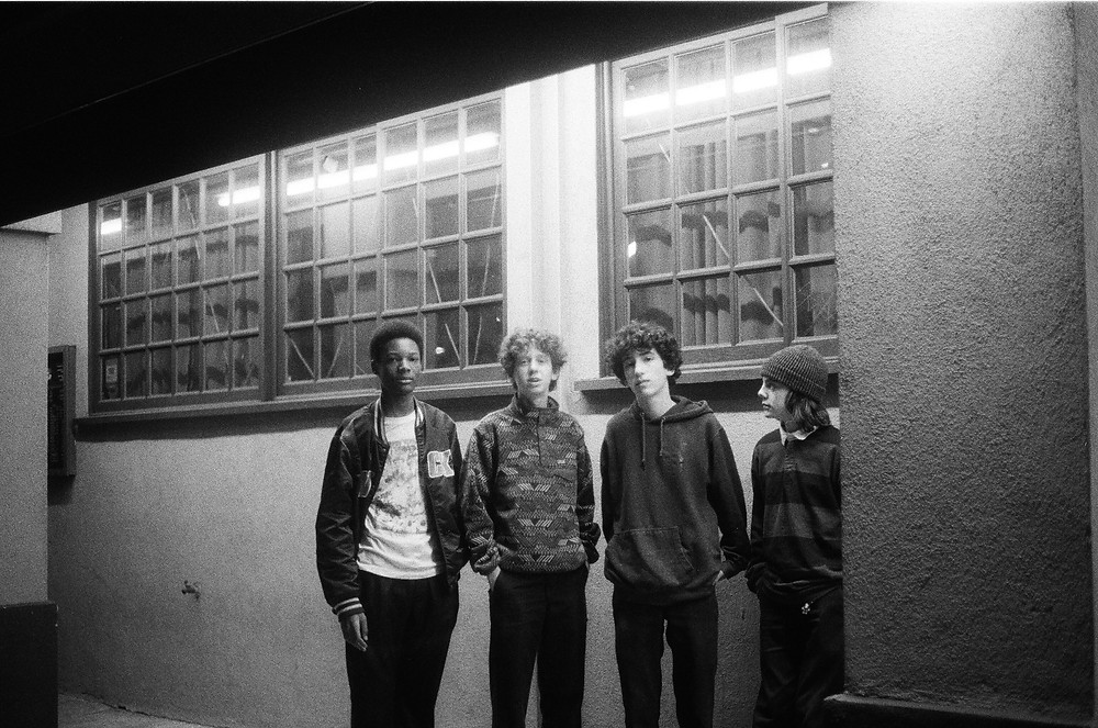 "A black and white image of the four members of the band ""Not From England"""