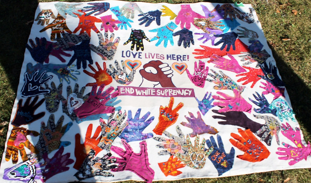 Love Lives Here, End White Supremacy banner, artistic leadership by Deb Reynolds