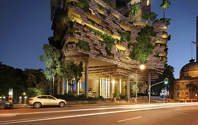 """Dubbed as the 'building that breathes"""", Architectus and WOHA designed Queensland's first truly subtropical apartment tower at 443 Queen St. Created for the Brisbane's climate, the building catches the breezes and shade from the sun, and is a habitable, living subtropical garden.   The building's footprint is minimised at the Queen Street level and raising and shaping the superstructure to maximise views. The ground plane elements are inspired by the natural riverside topography; the towers themselves rise airily above this abstract landform; clusters of screened pavilions forming fluted columns. These vertical clusters encase the open floating gardens at the heart.   443 Queen St received Australia's first 6 Star Green Star – Design and As-Built Version 1.2 Design Review certified rating for a residential tower by the Green Building Council of Australia (GBCA)."""