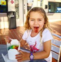 Girl eating snoball.jpg