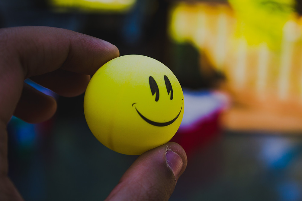 ping pong ball with painted smiling face pacman