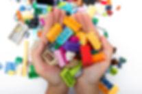 shutterstock_1430547632 lego hands.jpg