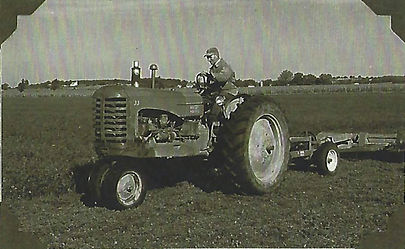 Great Grandpa on his Tractor.jpg