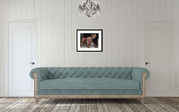 Framed boudoir image on wall above couch. Arthur Ellis photography Charleston SC