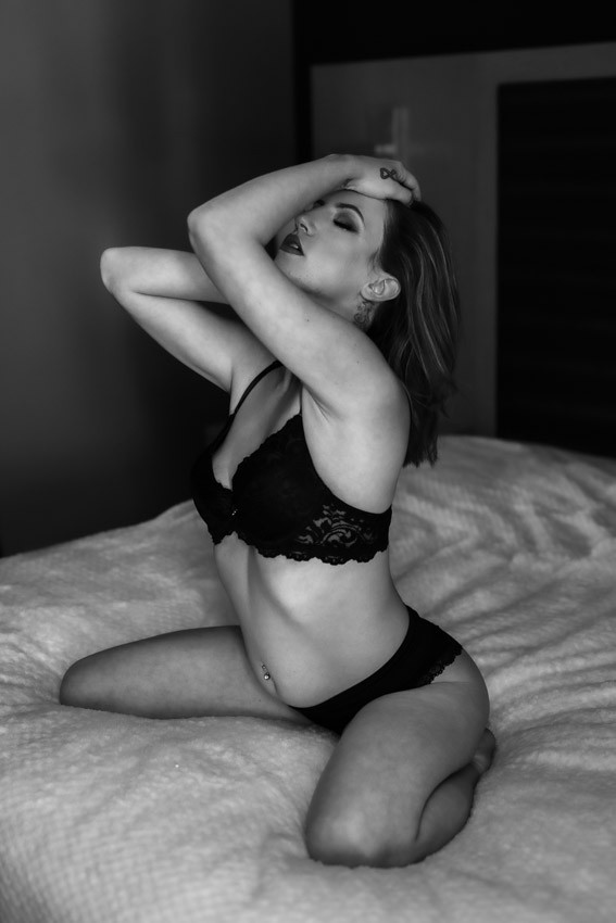 Women on bed enjoying boudoir photography