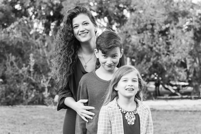 Mom, son and daughter posing for a photograph