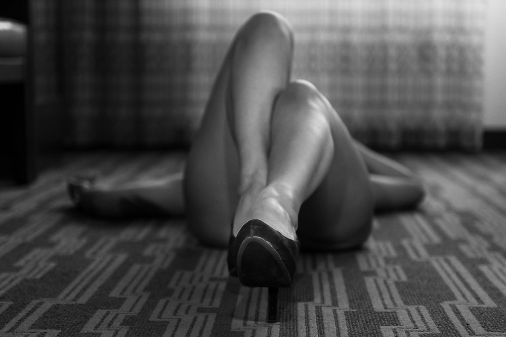 Woman on floor with her feet facing the camera