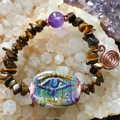 """Eye of houres"" lampwork bead, strung on tigers eye"