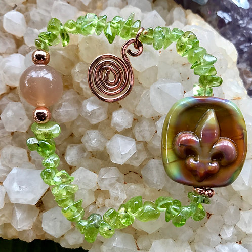 Fleur de lis silver glass lampwork bead, strung with peridot and moonstone